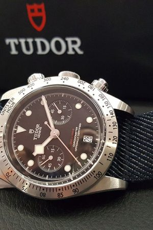 Tudor Black Bay Chrono with a modified Breitling B01 movement now called Calibre MT5813. Great denim-style fabric strap